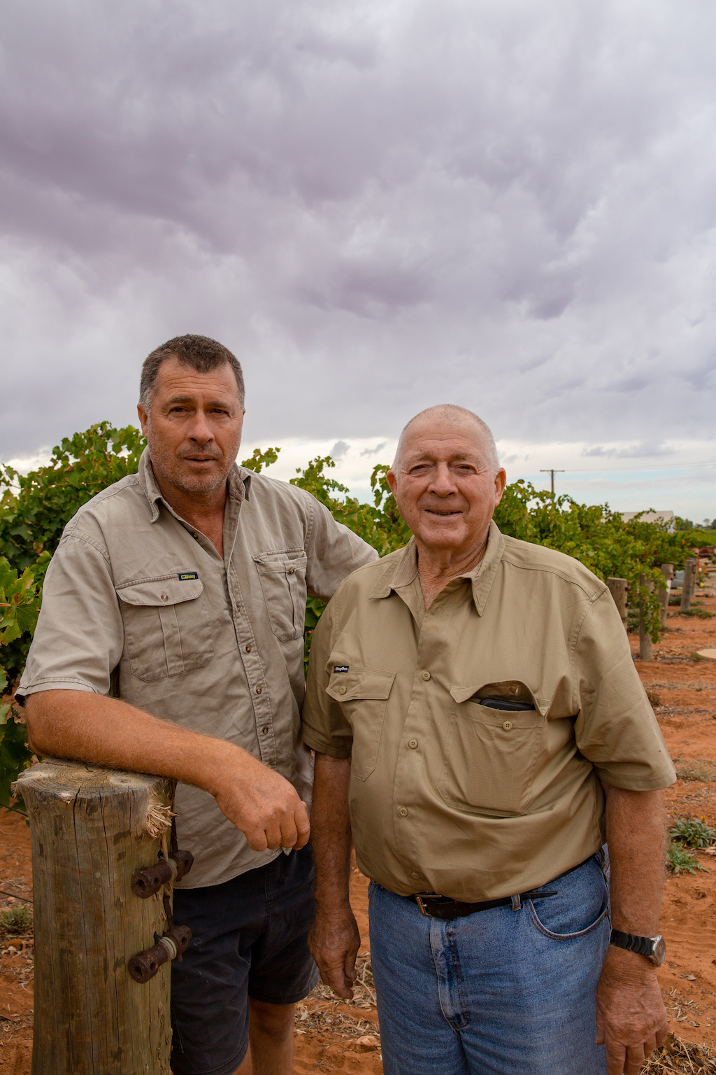 2 growers by grape vines